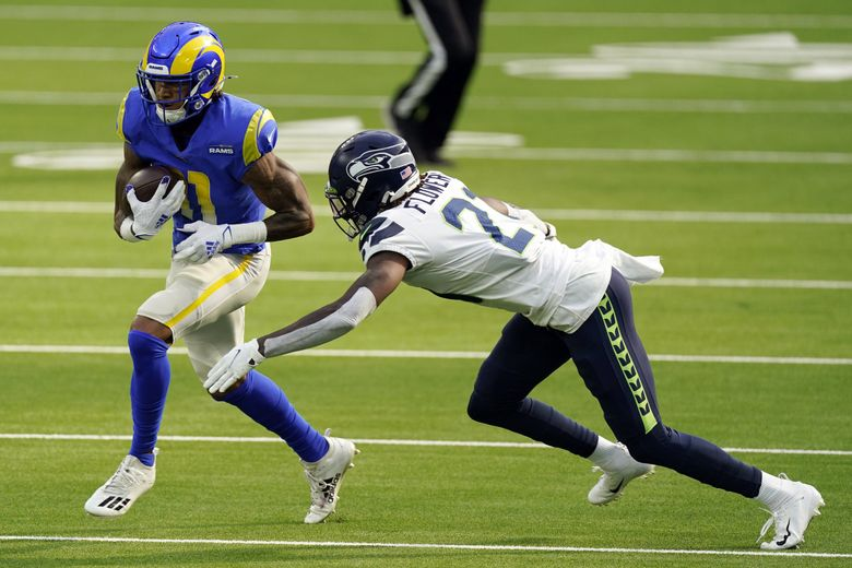 Los Angeles Rams wide receiver Josh Reynolds, left, runs next to Seattle Seahawks cornerback Tre Flowers during the first half of an NFL football game Sunday, Nov. 15, 2020, in Inglewood, Calif. (Ashley Landis / The Associated Press)