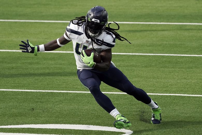 Seattle Seahawks running back Alex Collins runs against the Los Angeles Rams during the first half of an NFL football game Sunday, Nov. 15, 2020, in Inglewood, Calif. (Jae C. Hong / The Associated Press)