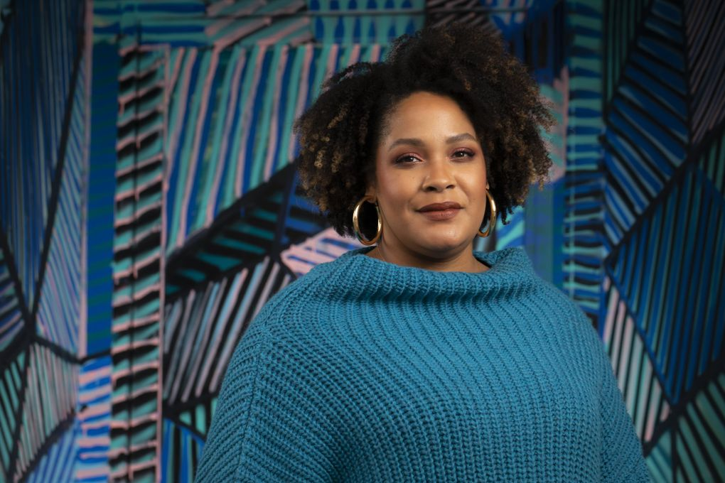 """Seattle author Ijeoma Oluo's latest is the upcoming book """"Mediocre: The Dangerous Legacy of White Male America."""" (Bettina Hansen / The Seattle Times)"""
