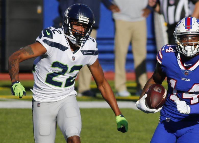 Buffalo Bills receiver Stefon Diggs runs away from Seahawks cornerback Quinton Dunbar in the first half Sunday in Orchard Park, New York. (Jeffrey T. Barnes / The Associated Press)