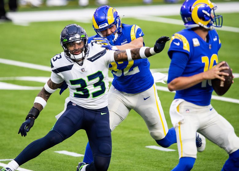 Seahawks strong safety Jamal Adams hits Los Angeles Rams quarterback Jared Goff to force a fumble in the first half Sunday in Los Angeles. (Andy Bao / Special to The Seattle Times)