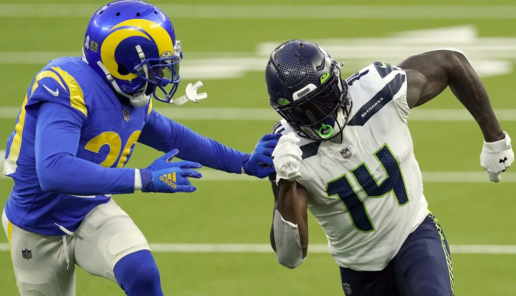 Seahawks wide receiver DK Metcalf is defended by Los Angeles Rams cornerback Jalen Ramsey on Sunday in Los Angeles. (Ashley Landis / The Associated Press)