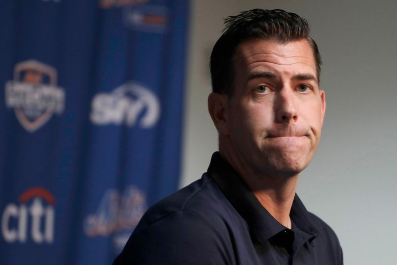 FILE – In this Feb. 14, 2019, file photo, New York Mets general manager Brodie Van Wagenen pauses while speaking to the media following spring training baseball practice in Port St. Lucie, Fla. Van Wagenen and many of his top aides are out, moves announced less than an hour after hedge fund manager Steve Cohen completed his $2.4 billion purchase of the team Friday, Nov. 6, 2020.   (AP Photo/Jeff Roberson, File)