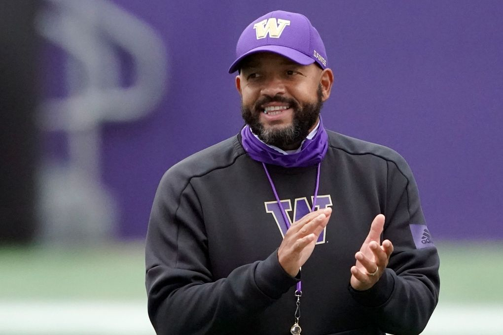 In this Friday, Oct. 16, 2020, file photo, Washington head coach Jimmy Lake watches his team during NCAA college football practice in Seattle.  (AP Photo/Ted S. Warren, File)