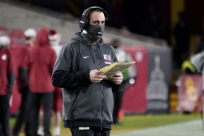 Washington State head coach Nick Rolovich looks on from the sidelines during the first half of an NCAA college football game against USC in December. (Alex Gallardo / The Associated Press)