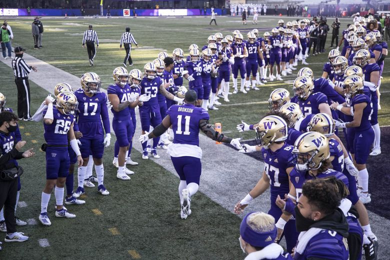 UW's Josiah Bronson is welcomed on to the field by his teammates on Senior Day ahead of a game vs. Stanford on Saturday, December 5, 2020 at Husky Stadium. (Dean Rutz / The Seattle Times)