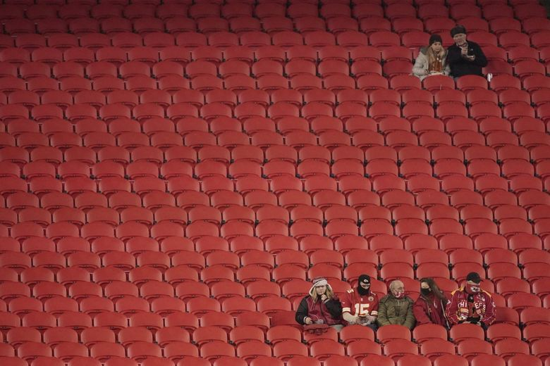 Fans watch warmups before the Kansas City Chiefs and the Denver Broncos game in Kansas City, Mo., on Sunday, Dec. 6, 2020. (Charlie Riedel / The Associated Press)