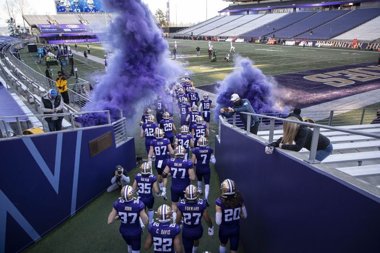 The Huskies come out for their game with Stanford on Dec. 5, 2020 at Husky Stadium in Seattle. (Dean Rutz / The Seattle Times)