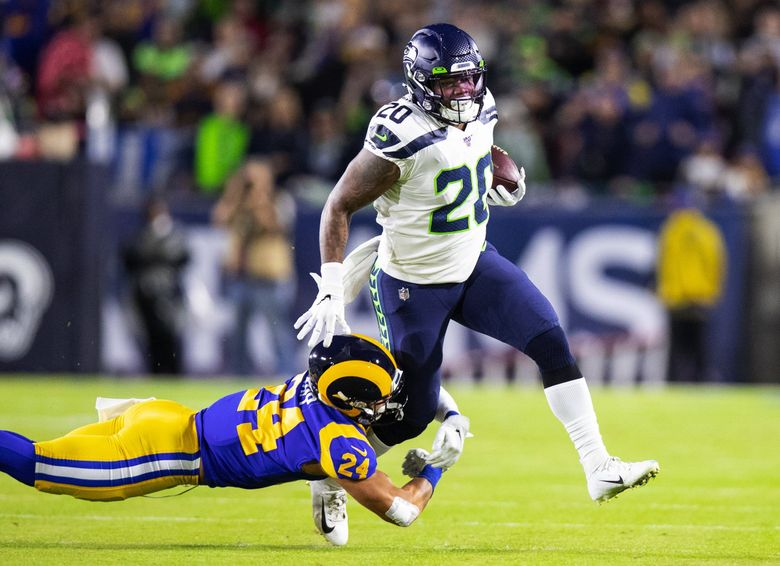 Seattle Seahawks running back Rashaad Penny (20) is brought down by Los Angeles Rams safety Taylor Rapp (24) during first quarter action as the Seattle Seahawks play the Los Angeles Rams at the Los Angeles Memorial Coliseum on Sunday December 8, 2019. (Mike Siegel / The Seattle Times)