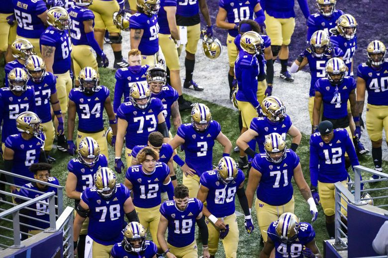 Players file into the tunnel after warmups and before the University of Washington Huskies take on the Utah Utes at Husky Stadium in Seattle Saturday November 28, 2020. (Bettina Hansen / The Seattle Times)