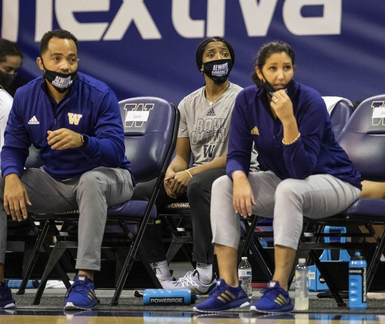 Tameiya Sadler (center) and coach Jody Wynn (right) are seen sitting on the bench during a UW women's basketball game. (Dean Rutz / The Seattle Times)