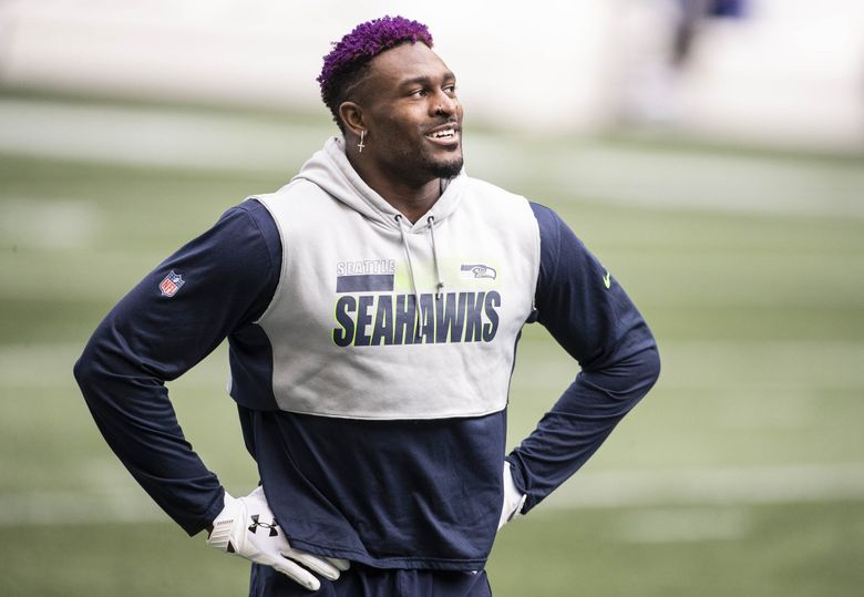 DK Metcalf warms up to play the New York Giants earlier this month. (Dean Rutz / The Seattle Times)
