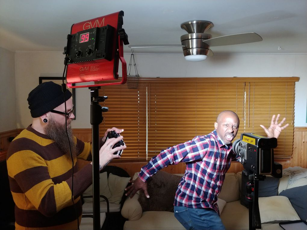 """Production team member Jason Austin, left, checks the lighting on the set of Anthony Thambynayagam's """"Figure Man,"""" starring Willie West, right. The film can be seen at the 9lb Hammer. (Anthony Thambynayagam)"""