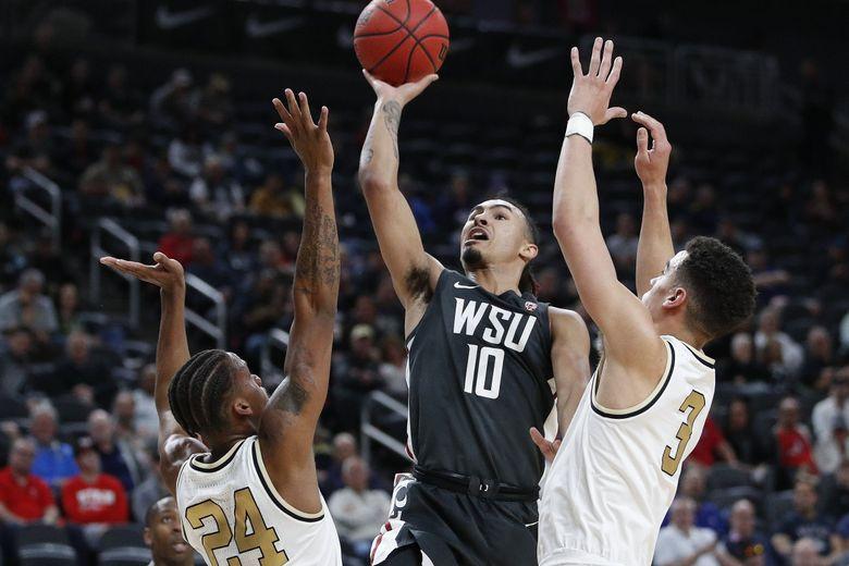 Washington State's Isaac Bonton (10) shoots over Colorado's Eli Parquet (24) in the final full game of the 2019-20 men's basketball season. (AP Photo/John Locher, File)  (John Locher / AP)