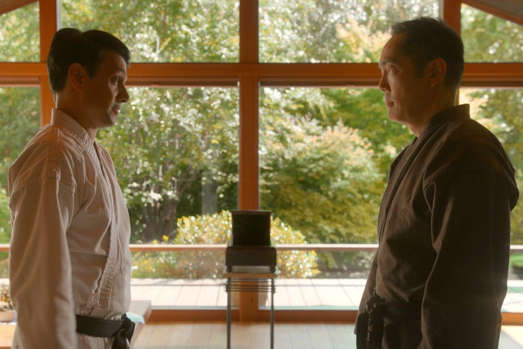 """Ralph Macchio, left, and Yuji Okumoto reprise their roles as Daniel and Chozen in Season 3 of Netflix's """"Cobra Kai."""" Okumoto played the character of Chozen, the villain, in 1986's """"The Karate Kid Part II."""" A few years later, he left Hollywood behind to move to Seattle and marry his wife, Angie.  (Courtesy of Netflix)"""