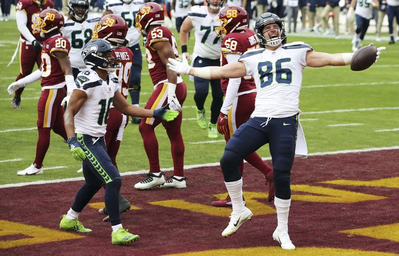 Seahawks tight end Jacob Hollister (86) celebrates after scoring a touchdown Sunday against the Washington Football Team in Landover, Md. (Daniel Kucin Jr. / The Associated Press)