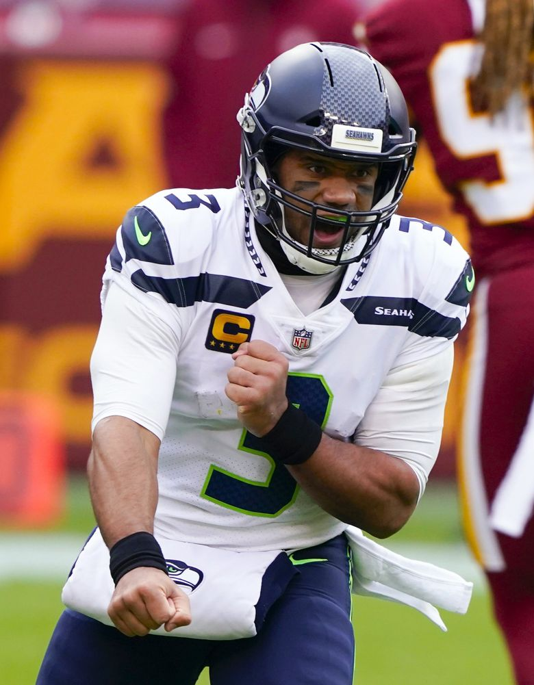 Seahawks quarterback Russell Wilson celebrates his touchdown pass to tight end Jacob Hollister in the first half Sunday against the Washington Football Team in Landover, Md. (Susan Walsh / The Associated Press)