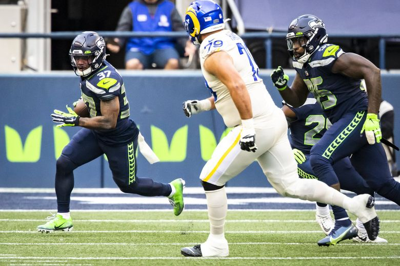 Seahawks free safety Quandre Diggs runs back an interception, picked off from Rams quarterback Jared Goff in the second quarter, as the Seattle Seahawks take on the Los Angeles Rams at Lumen Field in Seattle, Sunday December 27, 2020. (Bettina Hansen / The Seattle Times)