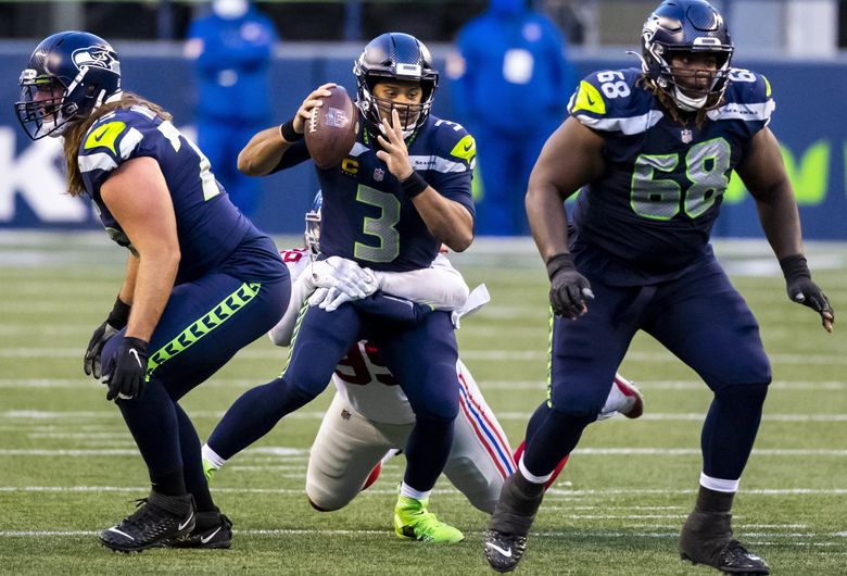 Seahawks quarterback Russell Wilson is sacked for a loss of 8 yards by Giants defensive end Leonard Williams on third down of their final drive as the Seattle Seahawks lose 17-12 to the New York Giants at Lumen Field in Seattle Sunday December 6, 2020. (Bettina Hansen / The Seattle Times)