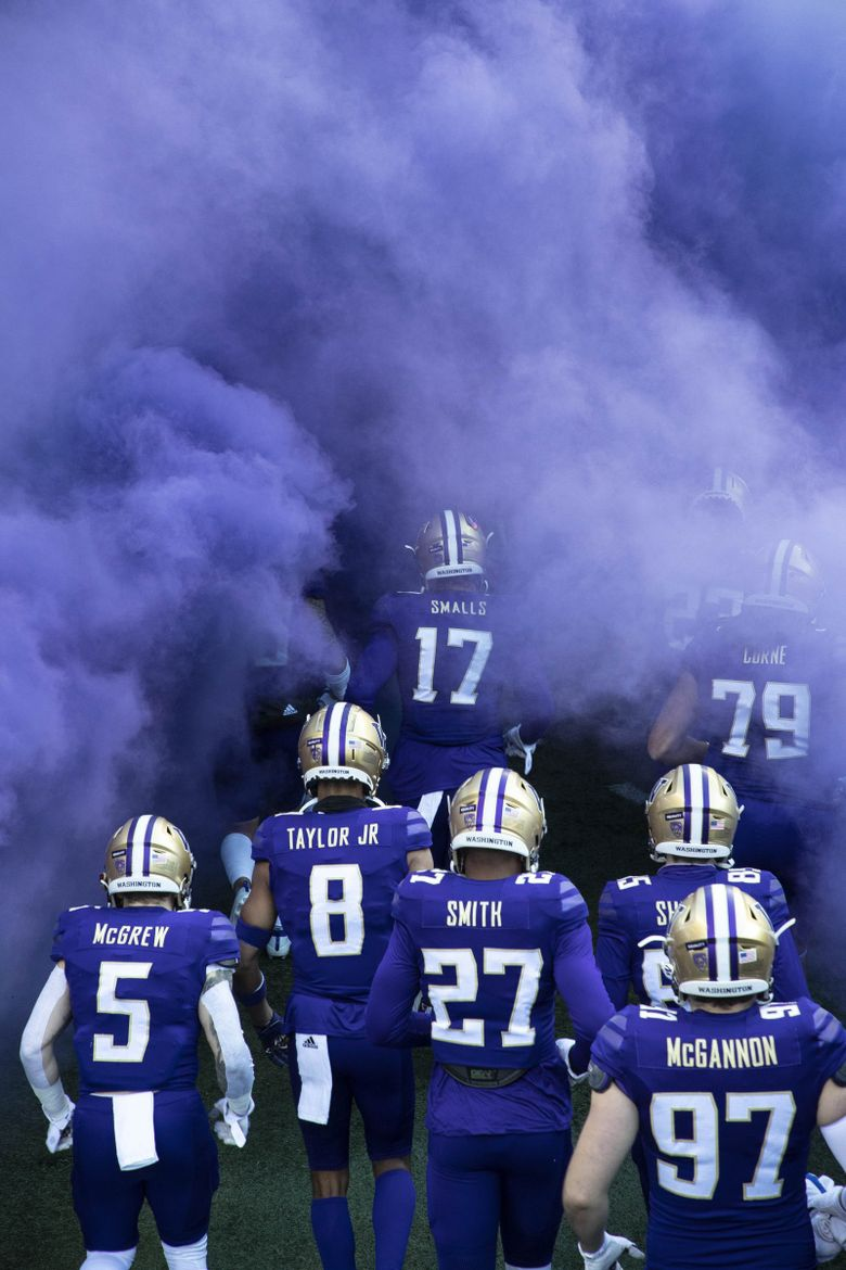 The Huskies come out for their football game with Stanford on Dec. 5 at Husky Stadium. It turned out to be their final game in a regular season that was shortened by COVID-19. (Dean Rutz / The Seattle Times)