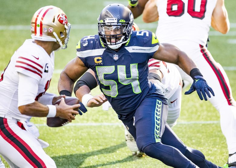 Seahawks middle linebacker Bobby Wagner sacks San Francisco 49ers quarterback Jimmy Garoppolo for a loss in the second quarter as the Seahawks take on the 49ers in Seattle on Sunday, Nov. 1, 2020.  (Bettina Hansen / The Seattle Times)