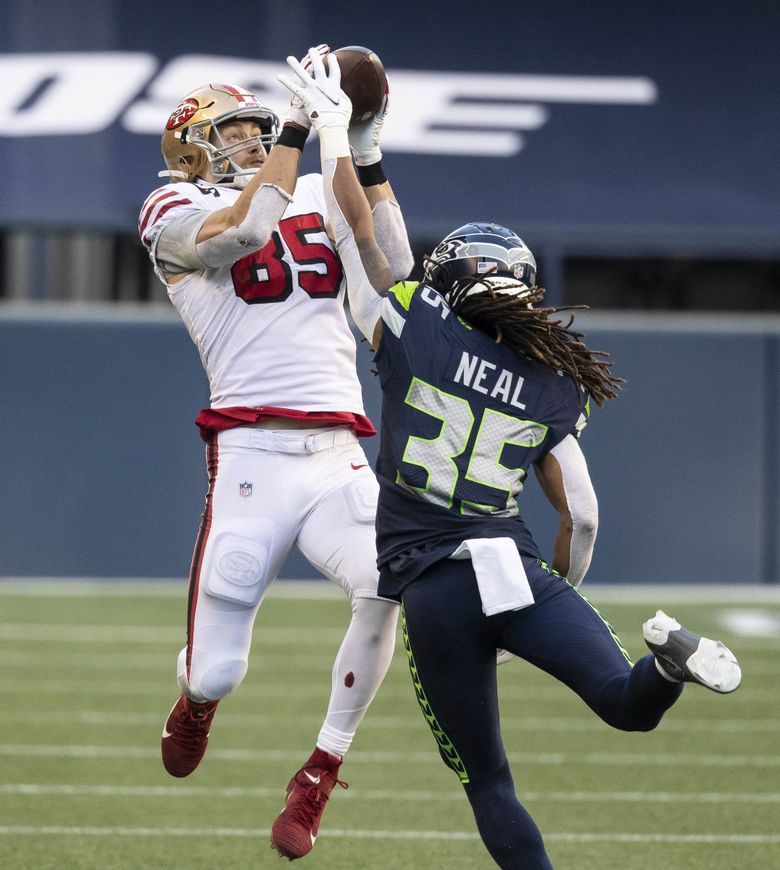 George Kittle beats Seattle cornerback Ryan Neal for the first down catch at the 37 in the 4th.  The San Francisco 49ers played the Seattle Seahawks in NFL action Sun day, November 1, 2020 at CenturyLink Field in Seattle, WA.  (Dean Rutz / The Seattle Times)