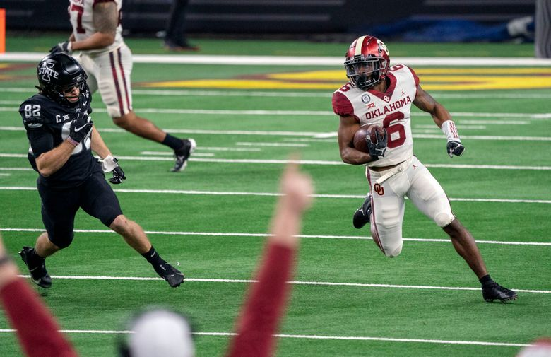 Oklahoma kick returner Tre Brown (6) turns the corner past Iowa State's Landen Akers (82) on a kickoff return during the first half of the the Big 12 Conference championship game last December in Arlington, Texas. (AP Photo/Jeffrey McWhorter)