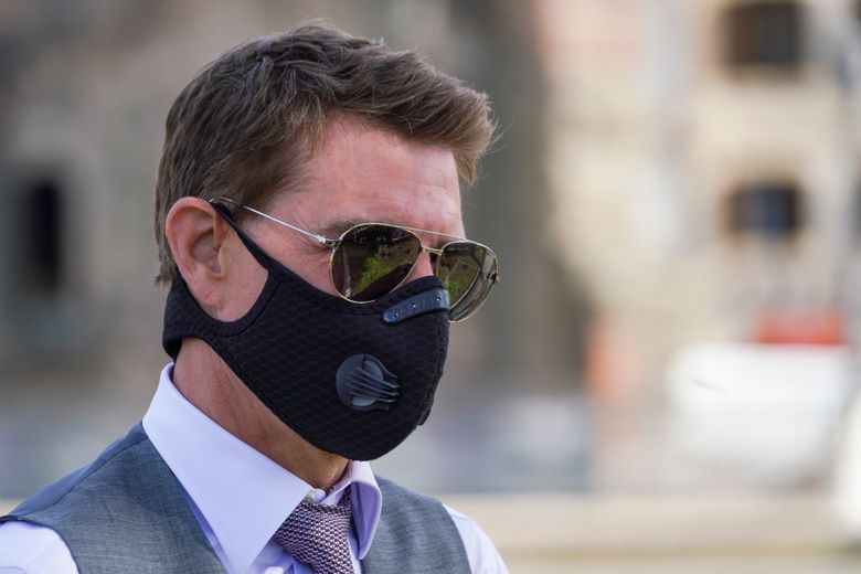"""FILE – In this Tuesday, Oct. 13, 2020 file photo, actor Tom Cruise wears a face mask to prevent the spread of COVID-19 as he greets fans during a break from shooting Mission Impossible 7, along Rome's Fori Imperiali avenue. Tom Cruise has launched an expletive-laden rant at colleagues on the set of his latest """"Mission: Impossible"""" movie after he reportedly spotted two workers failing to abide by social distancing rules. In audio released Wednesday, Dec. 16 by the Sun tabloid, the 58-year-old Hollywood megastar can be heard warning that anyone caught not following the rules to stay at least 2 meters (more than 6.5 feet) away from others will be fired. (AP Photo/Andrew Medichini, file)"""