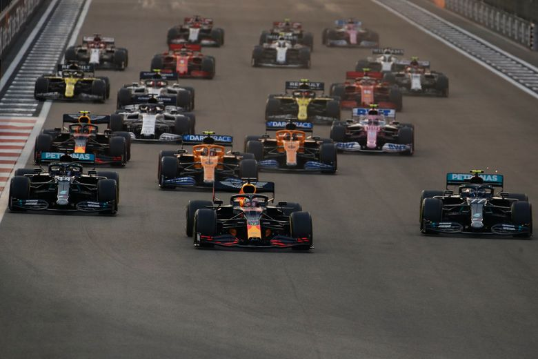Red Bull driver Max Verstappen of the Netherlands, centre, in action between Mercedes driver Lewis Hamilton of Britain and Mercedes driver Valtteri Bottas of Finland during the Formula One at the Yas Marina racetrack in Abu Dhabi, United Arab Emirates, Sunday, Dec.13, 2020. (Hamad Mohammed, Pool via AP)