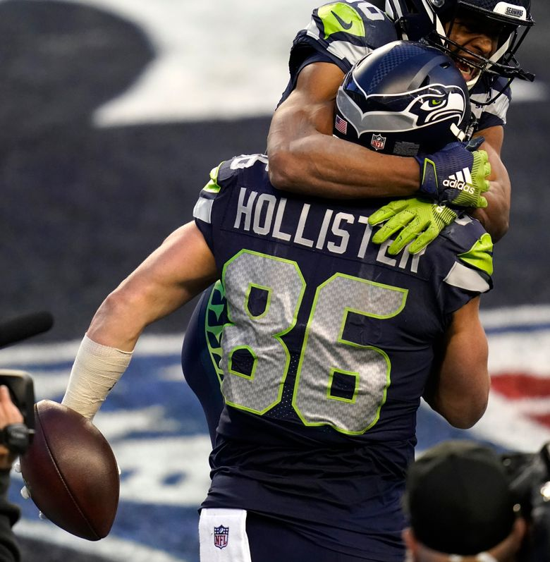 Seahawks tight end Jacob Hollister (86) celebrates with wide receiver Tyler Lockett, top, during the second half of the game against the Los Angeles Rams, Sunday, Dec. 27, 2020, in Seattle. The Seahawks won, 20-9. (AP Photo / Elaine Thompson)