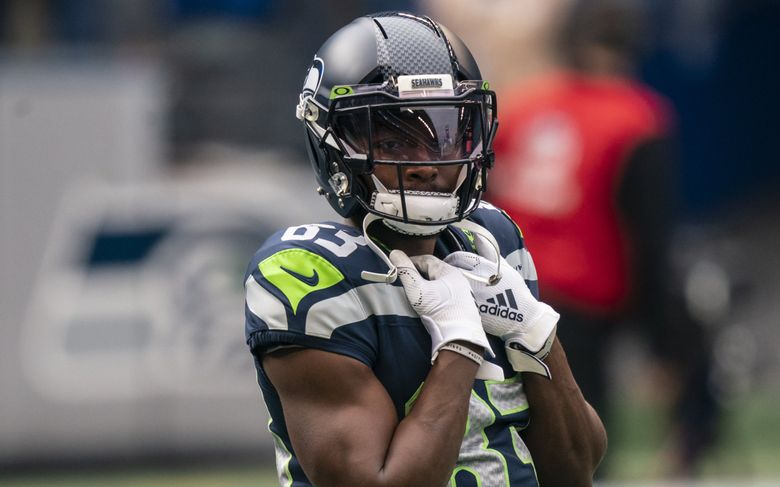 Seahawks wide receiver David Moore warms up before a game against the Lost Angeles Rams on Dec. 27, 2020, in Seattle. (Stephen Brashear / The Associated Press)
