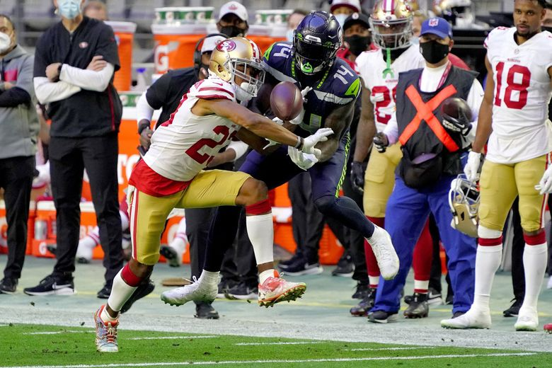 San Francisco 49ers cornerback Ahkello Witherspoon breaks up a pass intended for Seahawks wide receiver DK Metcalf (14) in the second half Sunday in Glendale, Ariz.  (Rick Scuteri / The Associated Press)