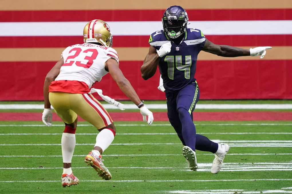 Seahawks wide receiver DK Metcalf (14) runs a route against San Francisco 49ers cornerback Ahkello Witherspoon (23) in the first quarter Sunday in Glendale, Ariz.  (Rick Scuteri / The Associated Press)
