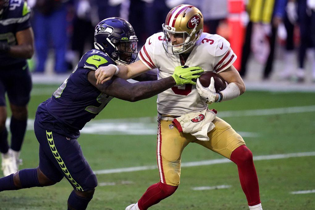 San Francisco 49ers quarterback C.J. Beathard (3) is sacked by  Seahawks defensive end Benson Mayowa on Sunday in Glendale, Ariz.  (Ross D. Franklin / The Associated Press)