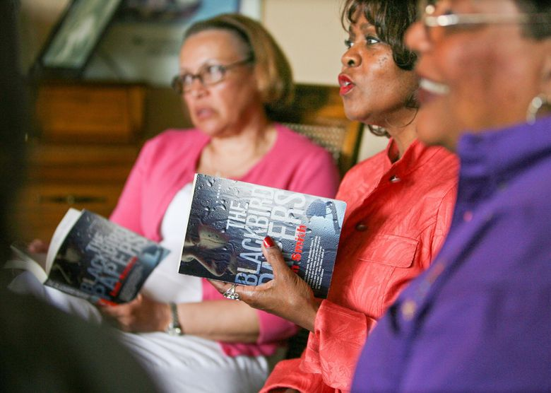 Members of The Book Club at their monthly meeting in 2007. From left, Pat Coleman, Patricia Tanner and Harriet Slye. (Steve Ringman / The Seattle Times, file)
