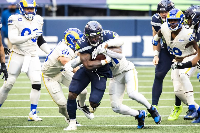 """Seahawks running back Chris Carson missed the playoffs last year with a broken hip but is ready to go this year. """"I just love the way (Carson) does it,"""" coach Peter Carroll said, (Bettina Hansen / The Seattle Times)"""