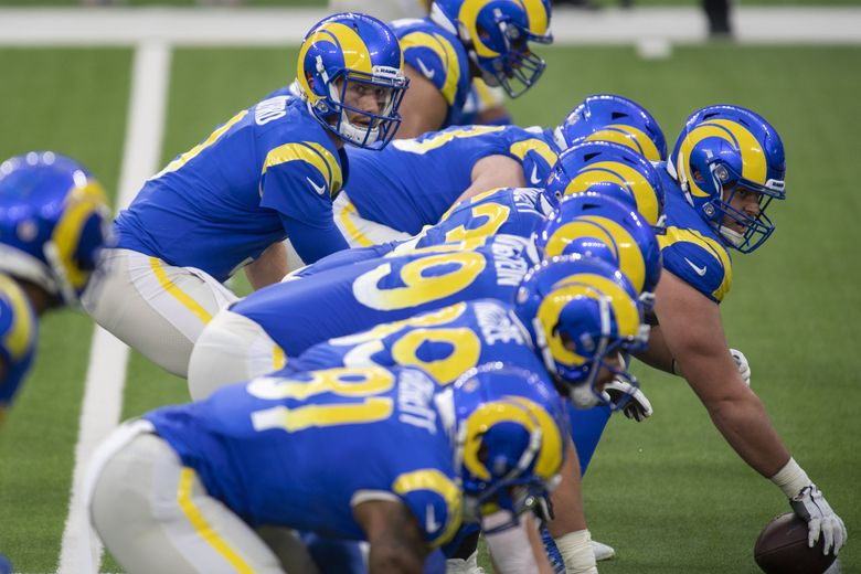 Los Angeles Rams quarterback John Wolford prepares to hike the ball against the Arizona Cardinals on Jan. 3, 2021, in Inglewood, Calif. (Kyusung Gong / AP)