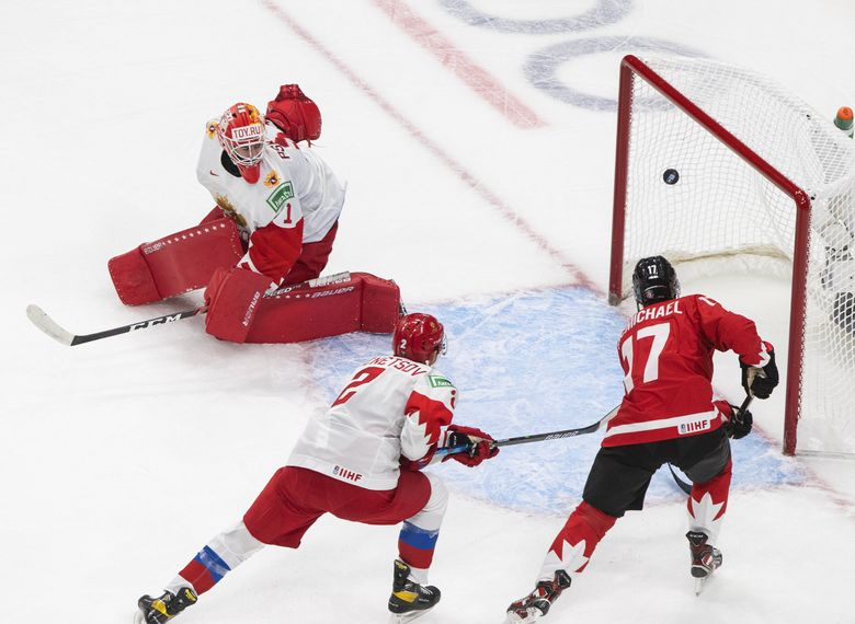 Canada's Connor McMichael (17) scores on Russia's Yaroslav Askarov (1) as Yan Kuznetsov (2) defends during Canada's win in the semifinals of the  World Junior Hockey Championships. (Jason Franson / The Canadian Press via AP)