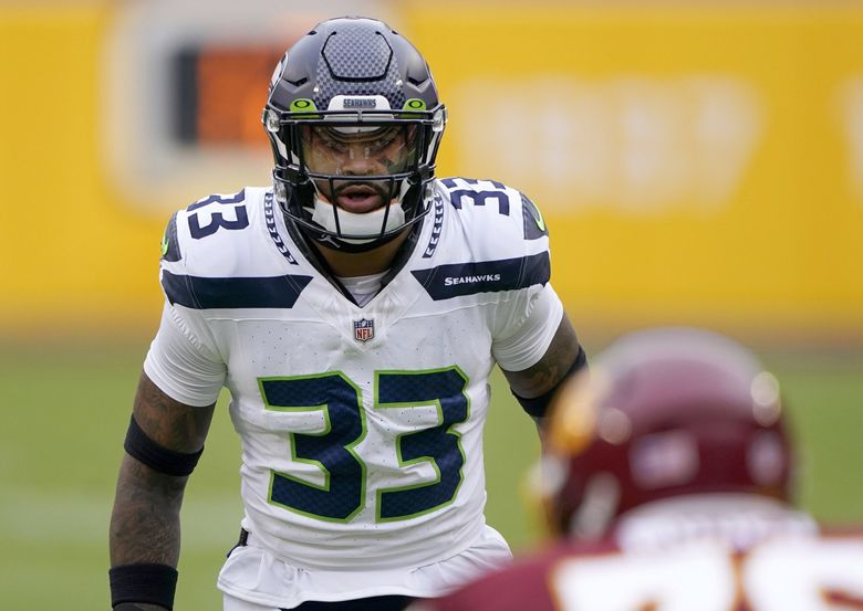 Seattle Seahawks strong safety Jamal Adams (33) looks across the line of scrimmage during an NFL football game against the Washington Football Team, Sunday, Dec. 20, 2020, in Landover, Md. (Mark Tenally / The Associated Press)
