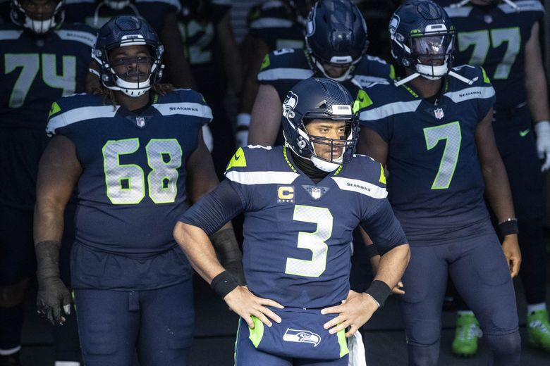 """Russell Wilson has led the Seahawks into the playoffs. """"He reminds me of the Tom Bradys and the Peyton Mannings — every year they seem to get better,"""" said Hall of Fame QB Kurt Warner. (Dean Rutz / The Seattle Times)"""