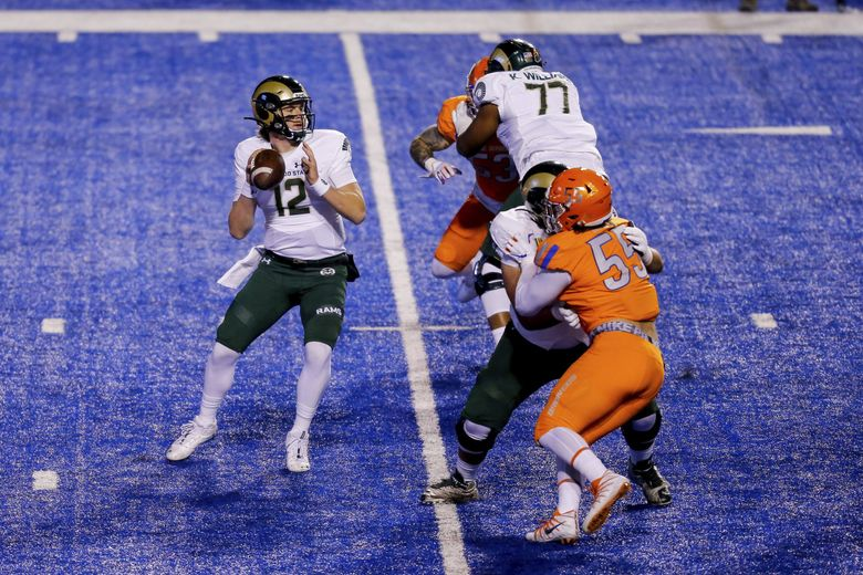Colorado State quarterback Patrick O'Brien (12) looks down field against Boise State during the first half in an NCAA college football game Thursday, Nov. 12, 2020, in Boise, Idaho. Boise State won 52-21. (AP Photo/Steve Conner)  (Steve Conner / AP)