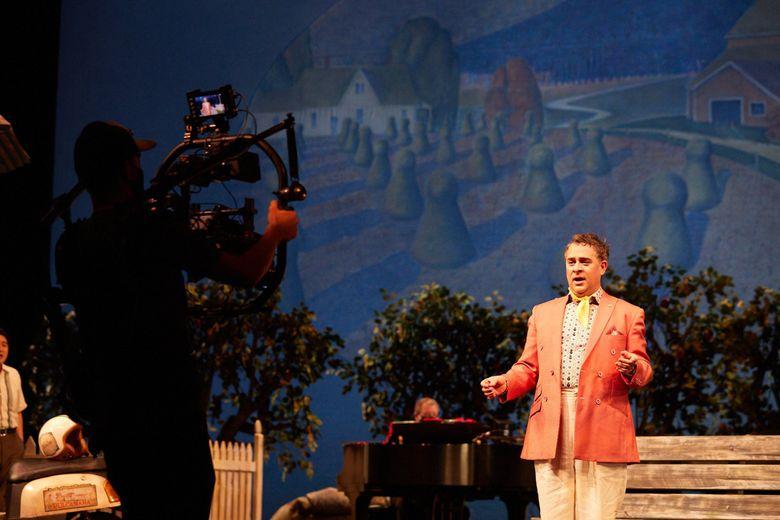 "Camera operator Justin Brown captures video of Patrick Cafizzi, who plays Dulcamara in Seattle Opera's ""Elixir of Love."" (Philip Newton)"