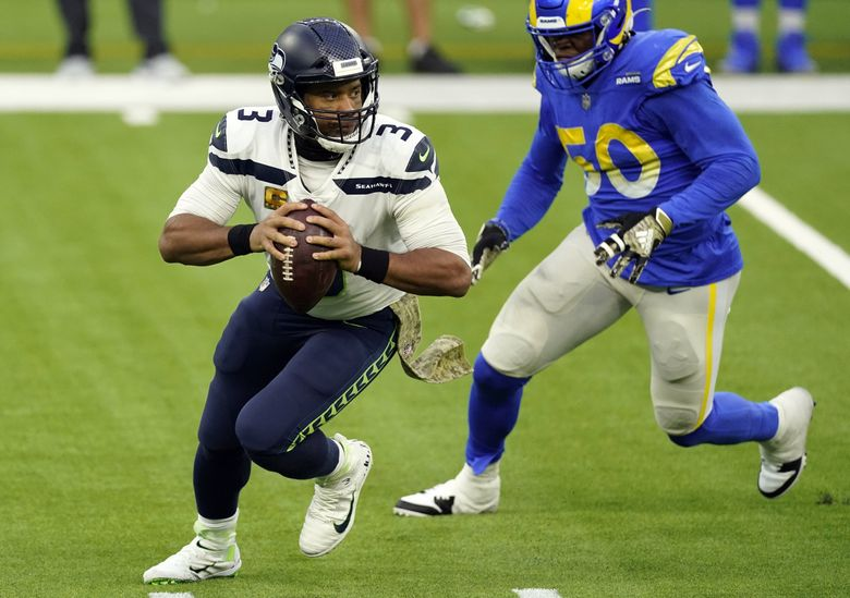 Seattle Seahawks quarterback Russell Wilson rolls out against the Los Angeles Rams during the second half of an NFL football game Sunday, Nov. 15, 2020, in Inglewood, Calif.  (Ashley Landis / The Associated Press)