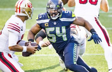 Seahawks middle linebacker Bobby Wagner sacks San Francisco 49ers quarterback Jimmy Garoppolo for a loss in the second quarter as the Seattle Seahawks take on the San Francisco 49ers at CenturyLink Field in Seattle Sunday November 1, 2020.  215510