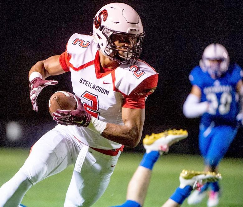 Steilacoom's Emeka Egbuka runs after a catch during a game against Eatonville in 2018. (Joshua Bessex / The Tacoma News Tribune, file)