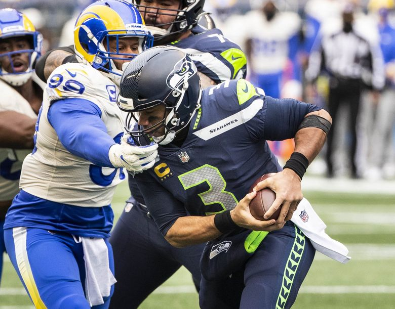Aaron Donald drops Russell Wilson on the 1-yard line in the 1st quarter, leaving Seattle 2nd and 34. (Dean Rutz / The Seattle Times)