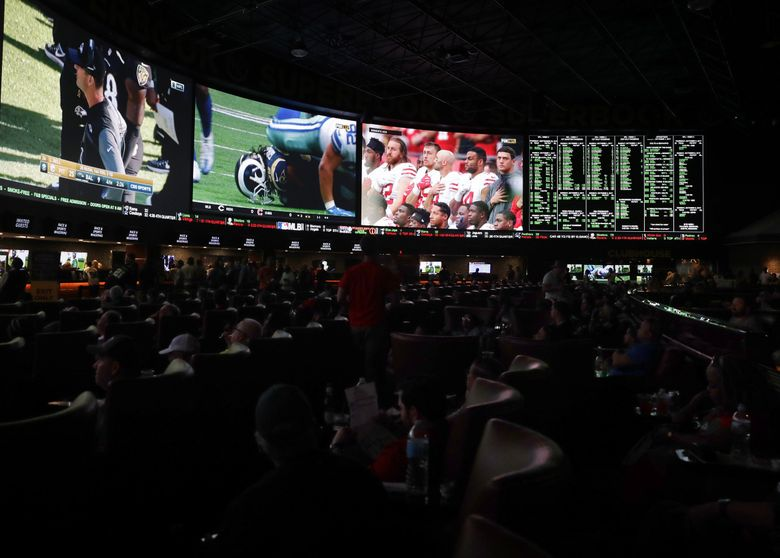 Sports gambling, which is big in Las Vegas at places like The Westgate SuperBook (above), is being debated in Washington. (Isaac Brekken / The New York Times)