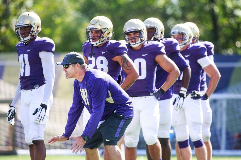 UW football defensive coordinator Pete Kwiatkowski works with players during practice in 2015. (Erika Schultz / The Seattle Times)