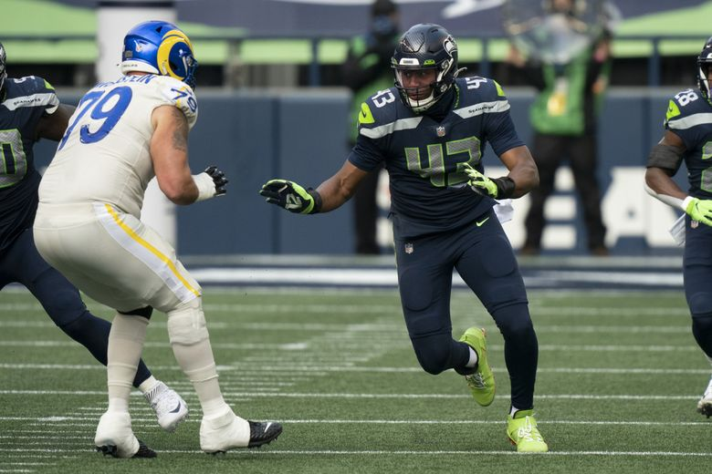 Seattle Seahawks defensive end Carlos Dunlap II is pictured during the first half of an NFL football game against the Los Angeles Rams, Sunday, Dec. 27, 2020, in Seattle.   (Stephen Brashear / The Associated Press)