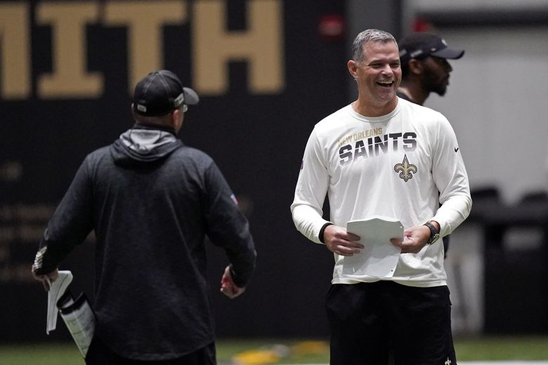 New Orleans Saints quarterbacks coach Joe Lombardi, right, laughs with offensive coordinator Pete Carmichael during practice at their NFL football training facility in Metairie, Louisiana, Wednesday, Sept. 2, 2020. (AP Photo/Gerald Herbert, Pool) (Gerald Herbert / AP)